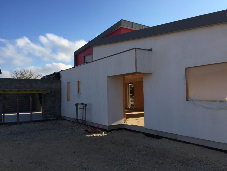 Contruction d 39 une maison individuelle ossature bois isolation fibre de bois for Isolation maison bois